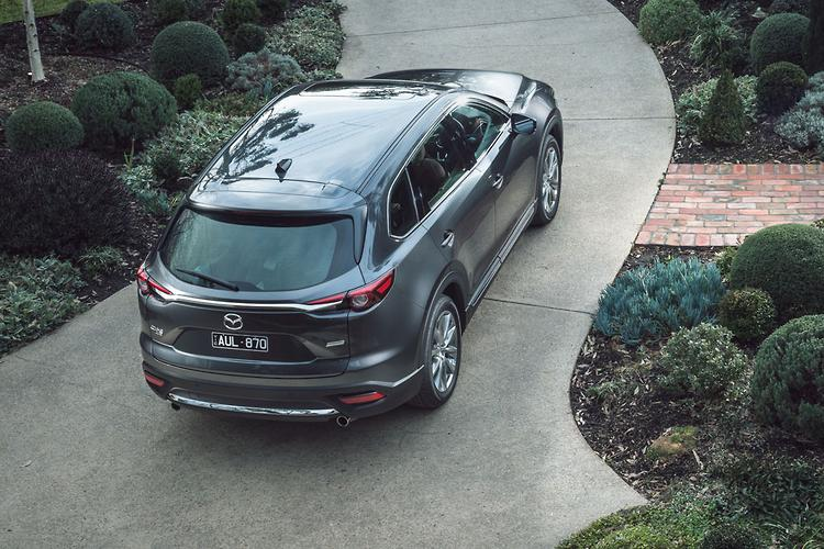 How Much Does The 2019 Mazda CX 9 Cost? Sport FWD U2014 $44,990. Sport AWD U2014  $48,990. Touring FWD U2014 $51,390. Touring AWD U2014 $55,290. GT FWD U2014 $59,390